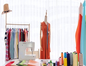 fashion designer working studio with sewing items materials working table 123766 137 600x338 1